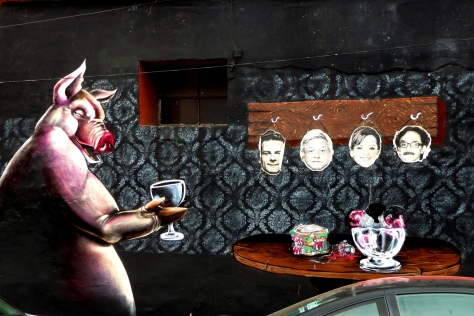 Outside Espacio Zapata - political heads on hooks