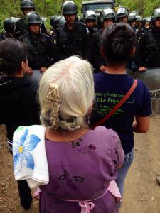 Women face the police line. Photo courtesy of Guatemalan Human Rights Commission