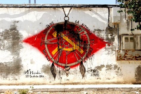 Mural along the main road through Marinaleda - 'Catch your dreams, utopia is possible'